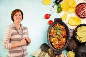 Photo of Kori McClurg Melita's Table Founder with Fresh Food Ingredients